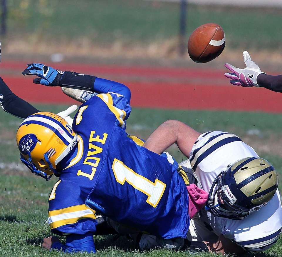 East Meadow's Anthony Love loses the ball against
