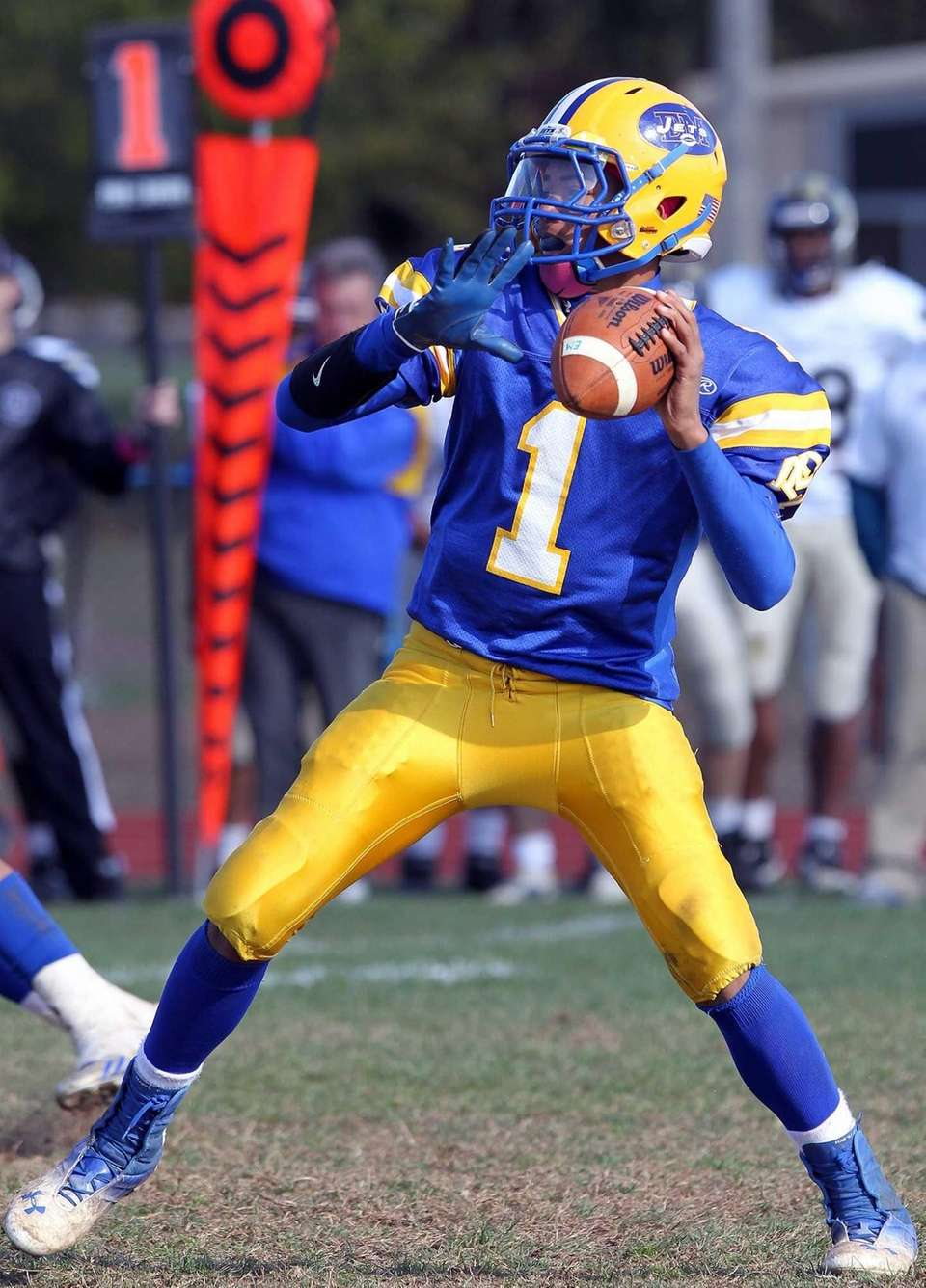 East Meadow's Anthony Love sets to pass against