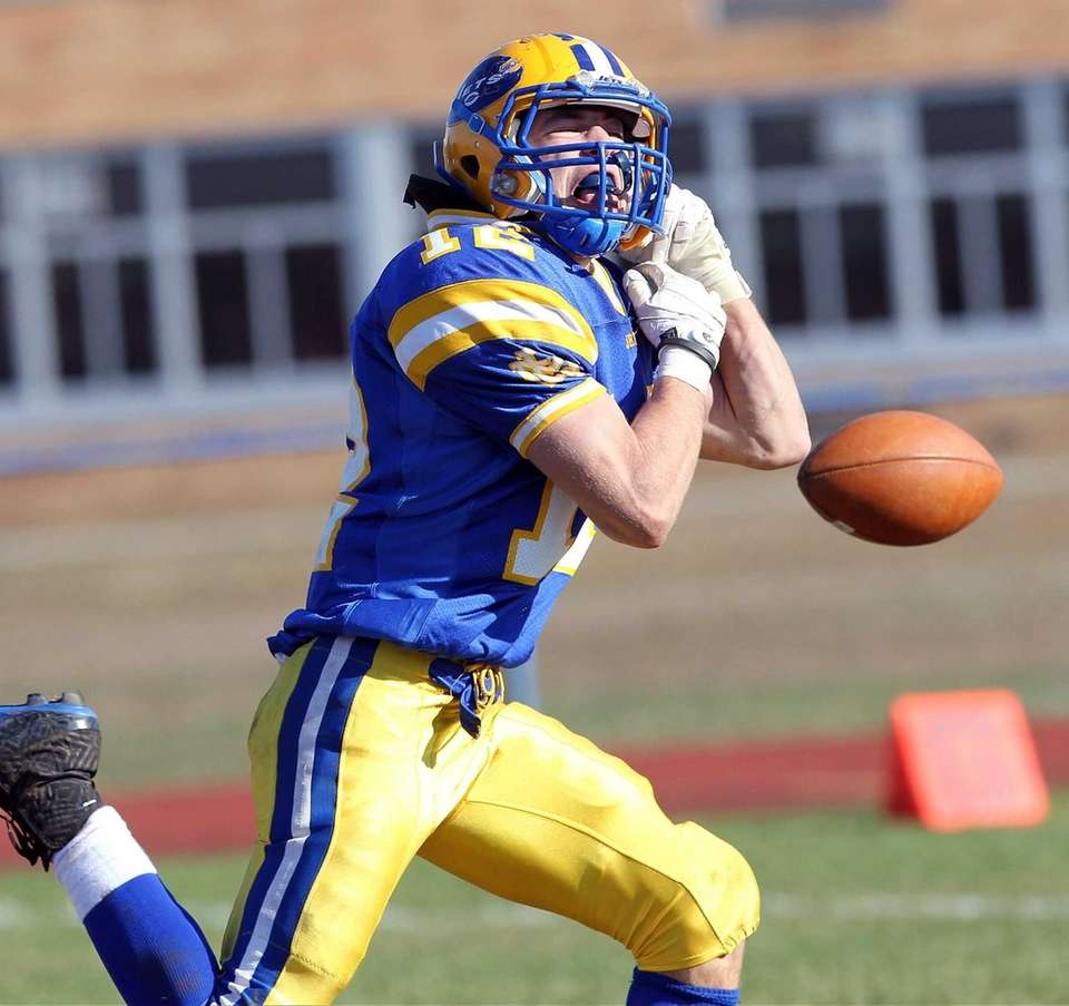 East Meadow's Nick Suchocki tries to catch a