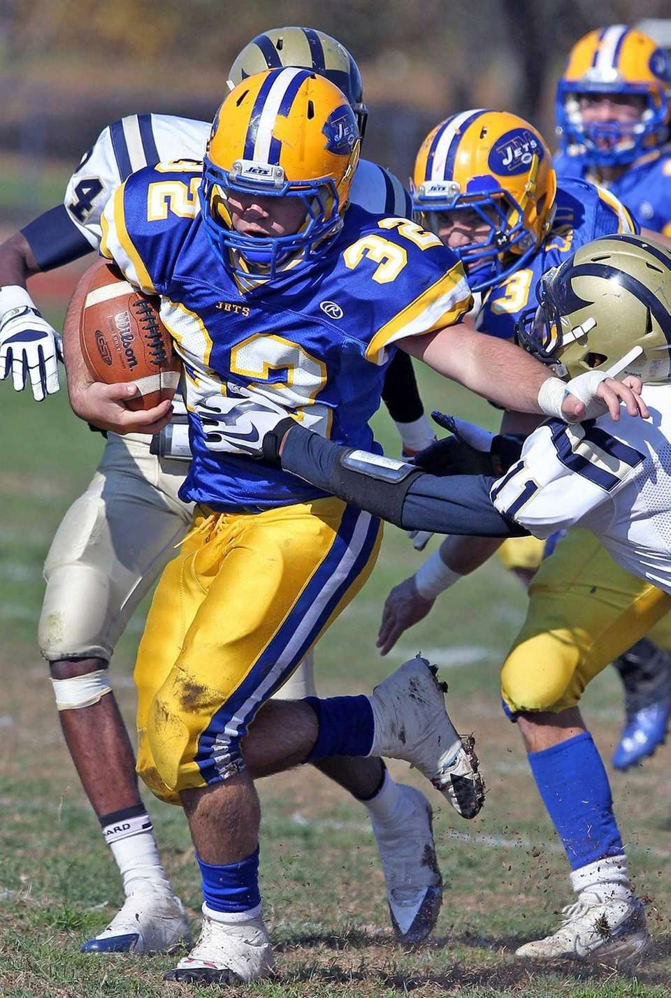 East Meadow's John Wilson runs 28 yards for