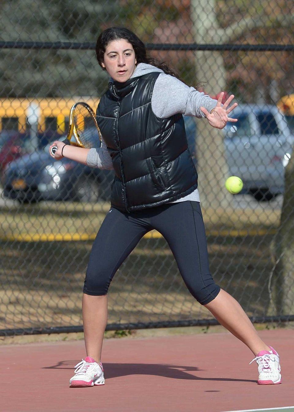 Ester Chikvashvili of Hills East hits a forehand
