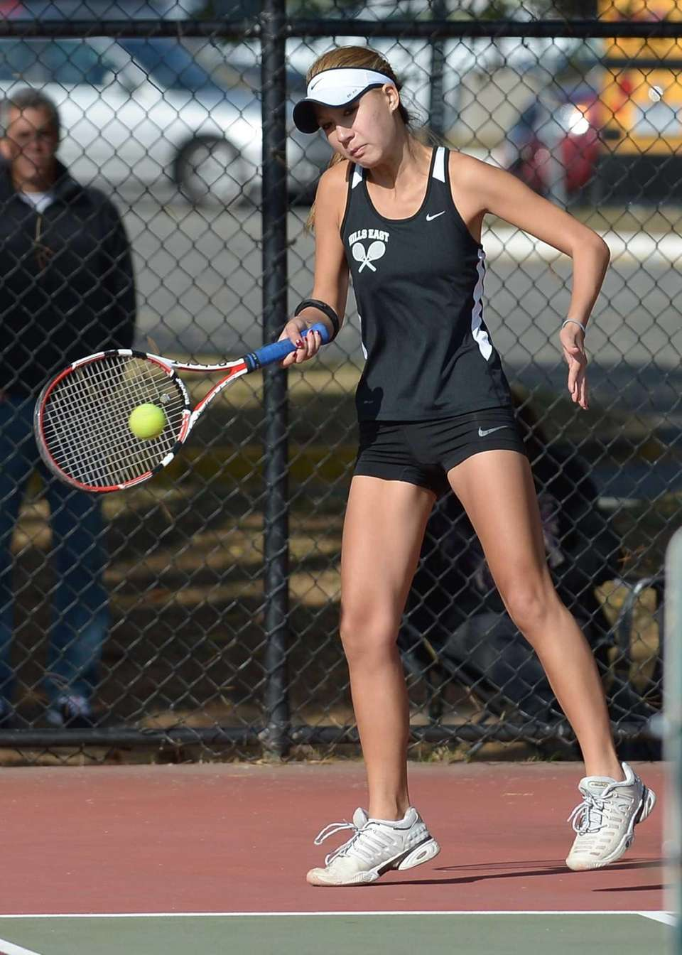 Natalie Haedich hits a forehand return during her