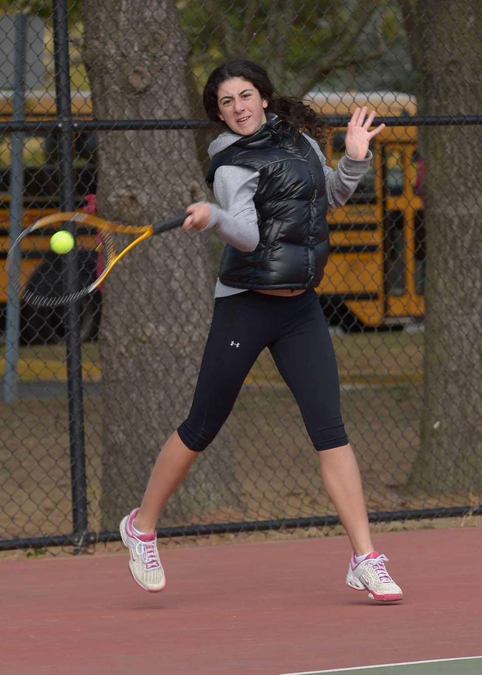 Ester Chikvashvili of Hills East returns the serve