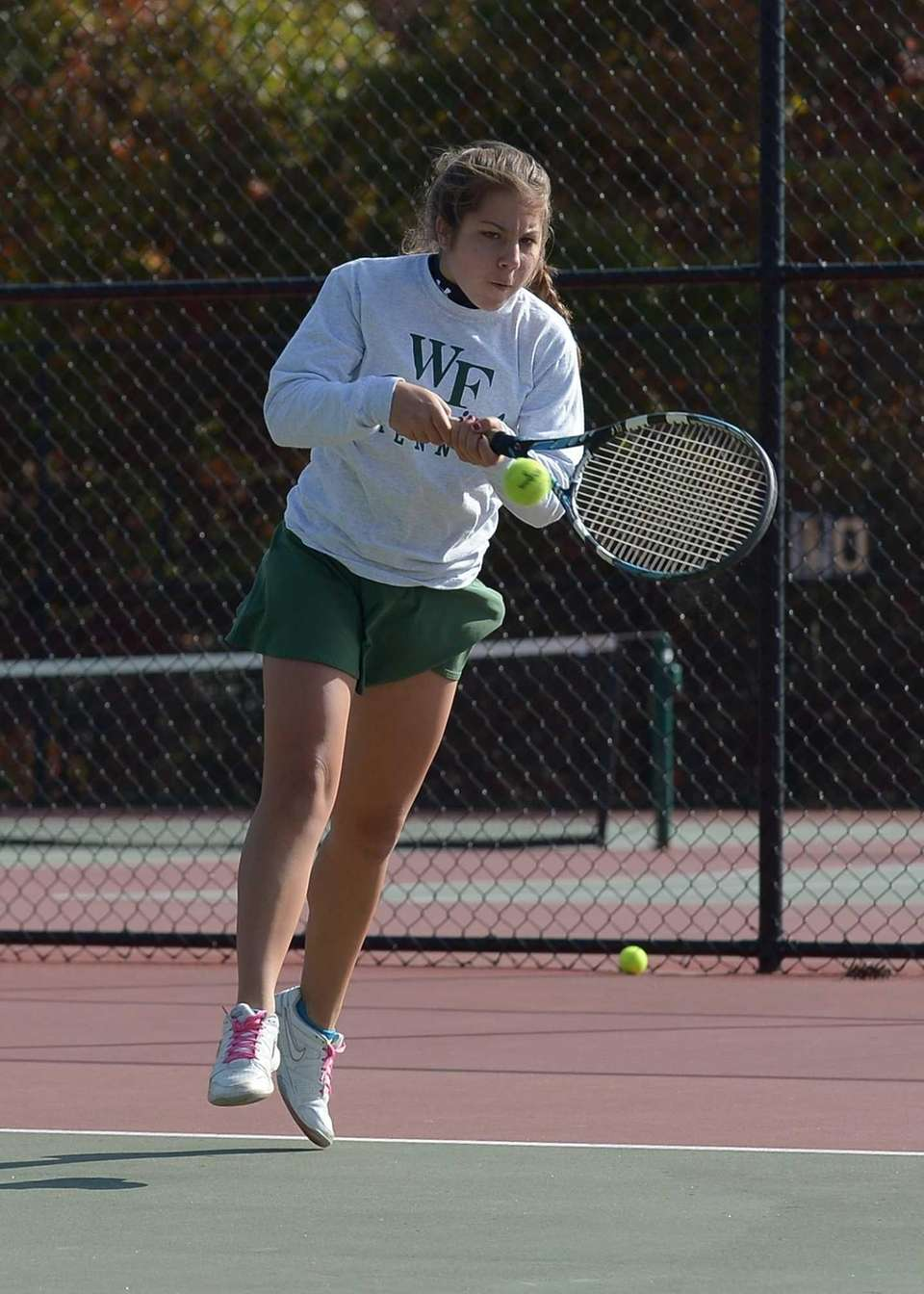 Christina Cali of William Floyd with a forehand