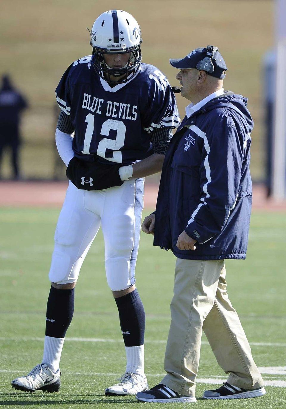 Huntington head coach Steve Muller directs quarterback Ben