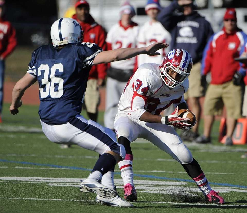 Bellport's Jabari M'Bhaso moves to evade a tackle