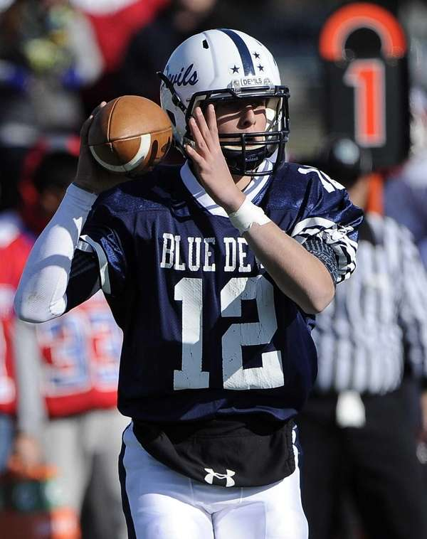 Huntington quarterback Ben Kocis looks to pass against