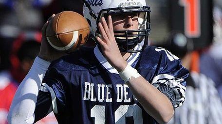Huntington quarterback Ben Kocis looks to pass against