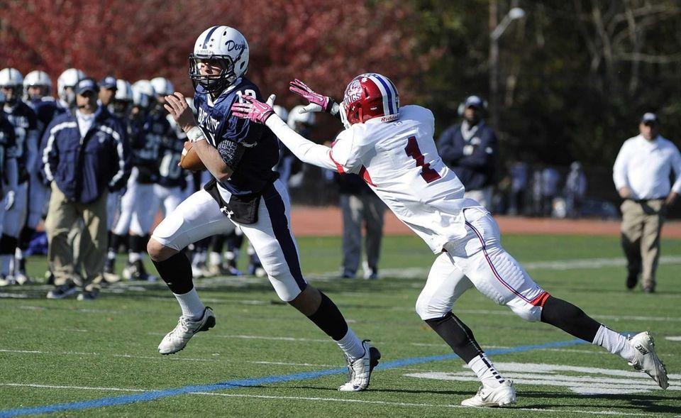 Huntington quarterback Ben Kocis tries to get past