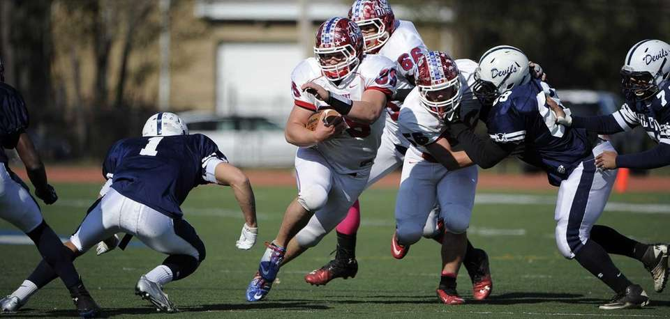 Bellport's Conor Haverty looks for running room against