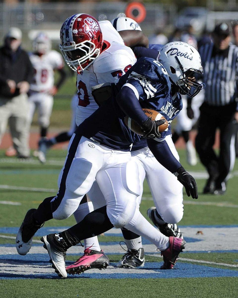 Huntington's Levar Butts runs the football against Bellport
