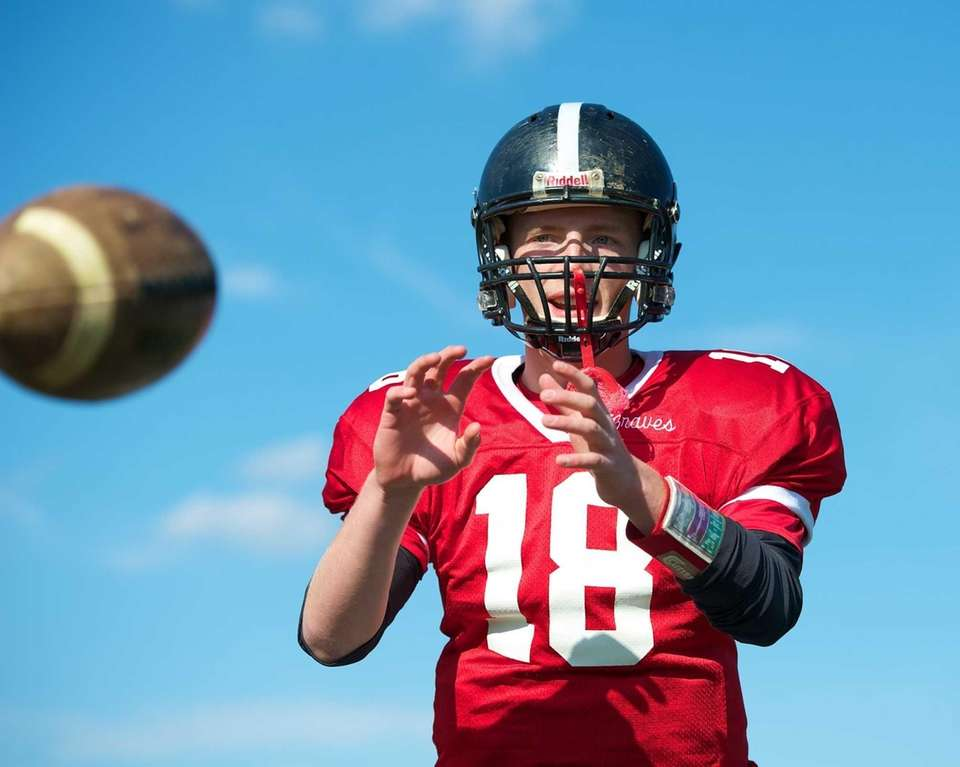 Syosset quarterback Joe Majoy warms up prior to