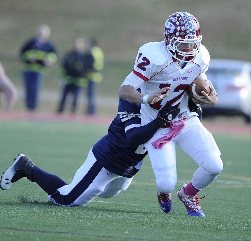 Huntington's Levar Butts tackles Bellport quarterback Nick Fountis