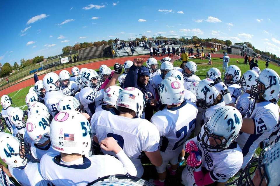 The Oceanside football team huddles around Oceanside head