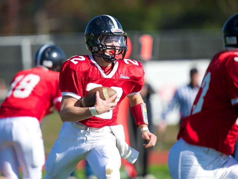 Syosset running back Anthony Carchietta looks for an