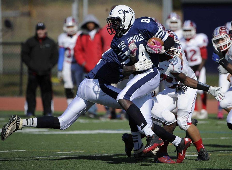 Huntington's Infinite Tucker runs the football against Bellport