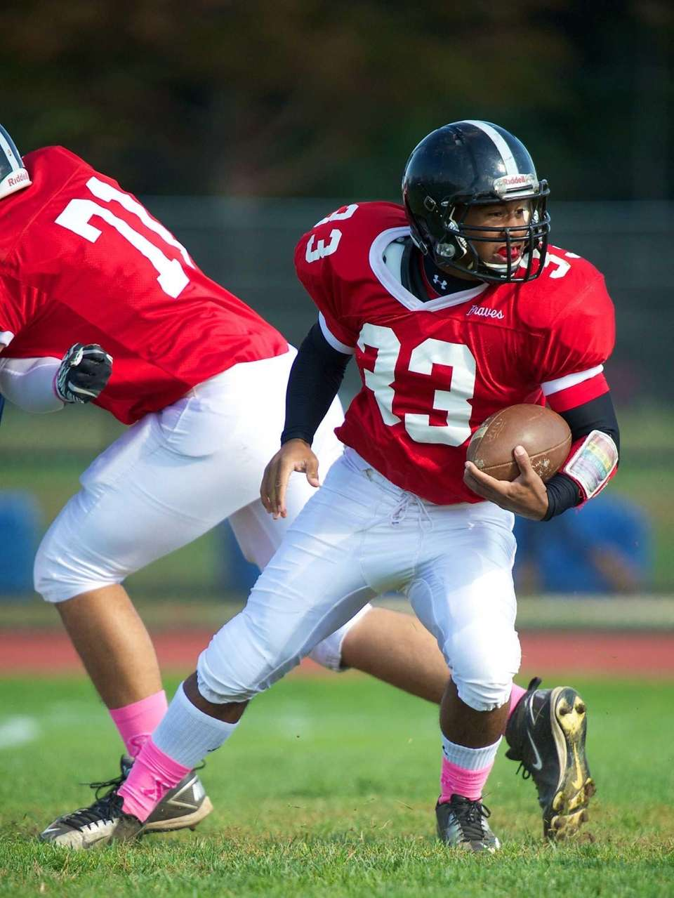 Syosset running back Brandon Nieves runs the ball