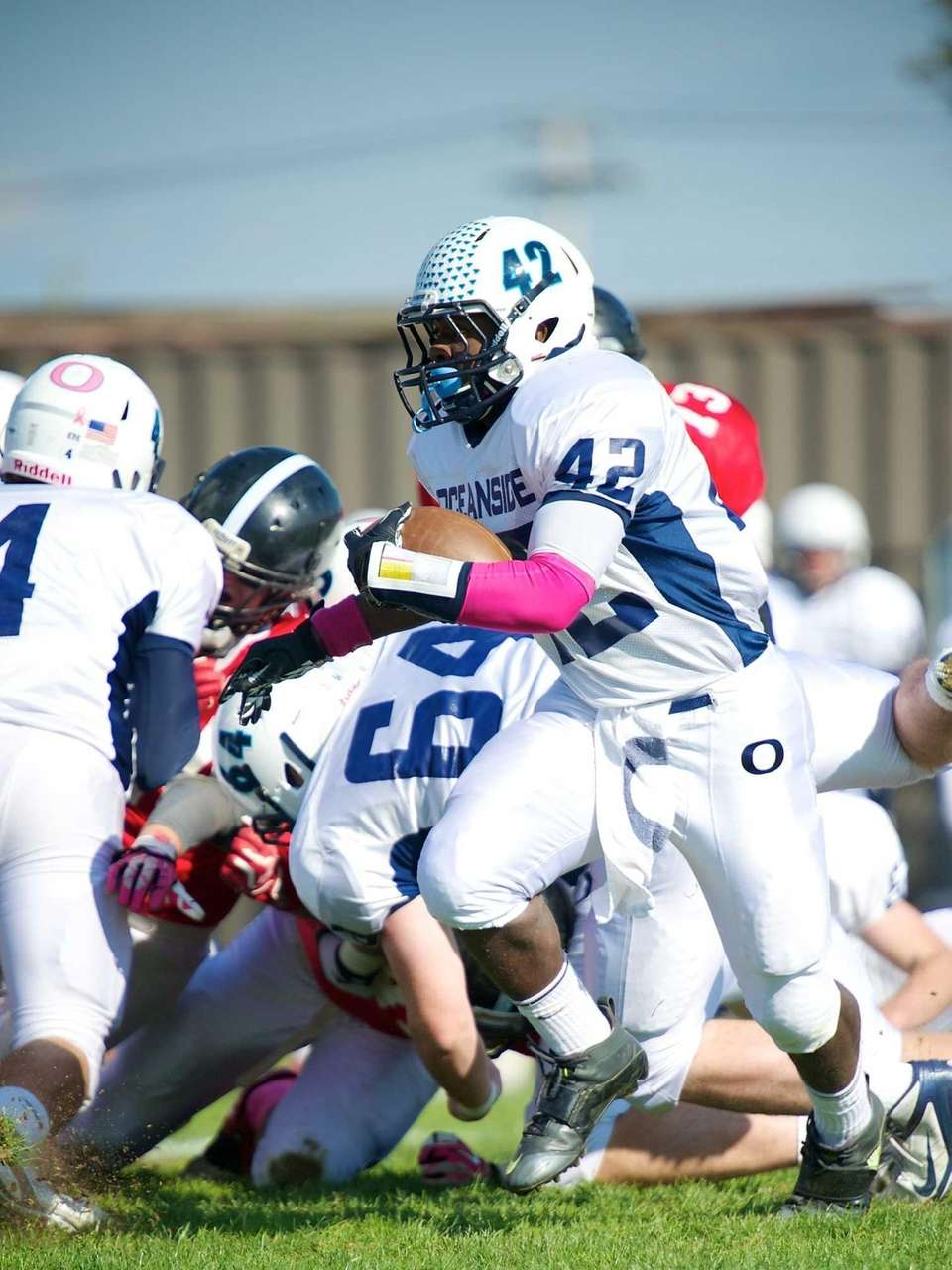 Oceanside running back Tariek Harris breaks to the