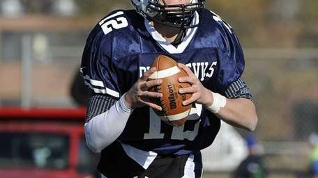 Huntington quarterback Ben Kocis drops back to pass