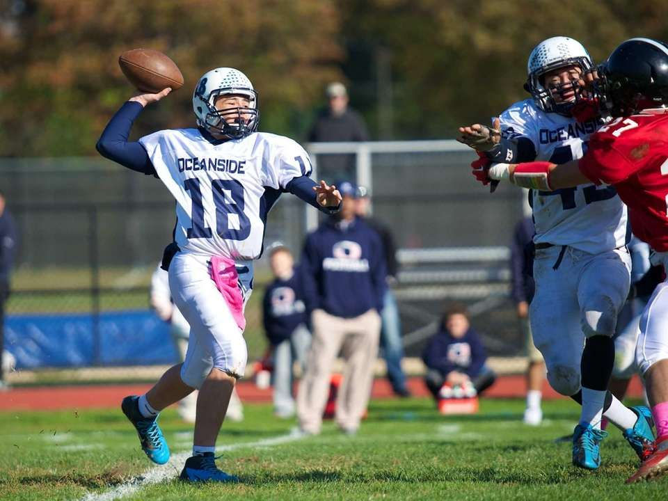 Oceanside quarterback Vincent Guarino throws a pass attempts