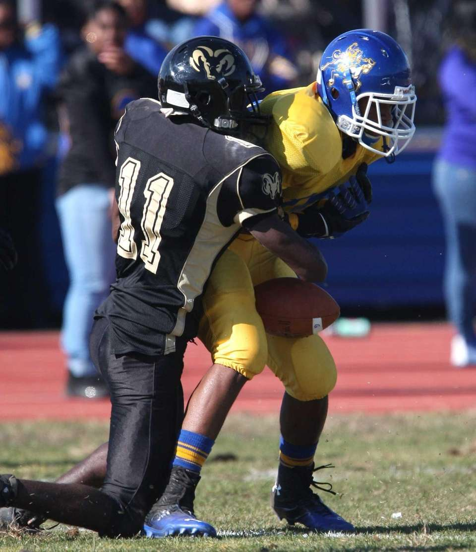 Roosevelt's Kyle Moore (no. 19) gets wrapped up