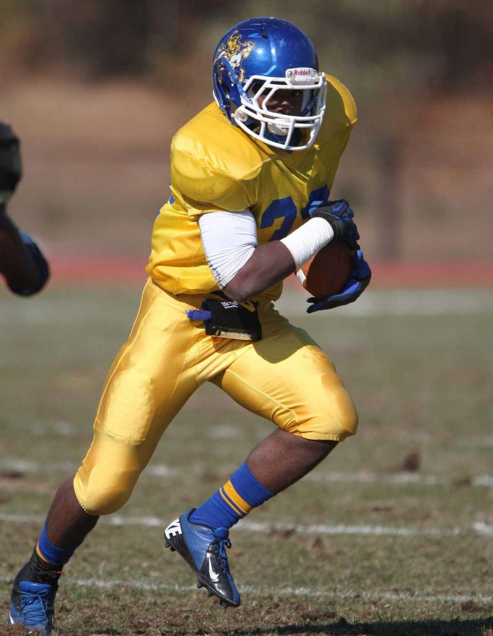 Roosevelt's Johnnie Akins carries the ball against West