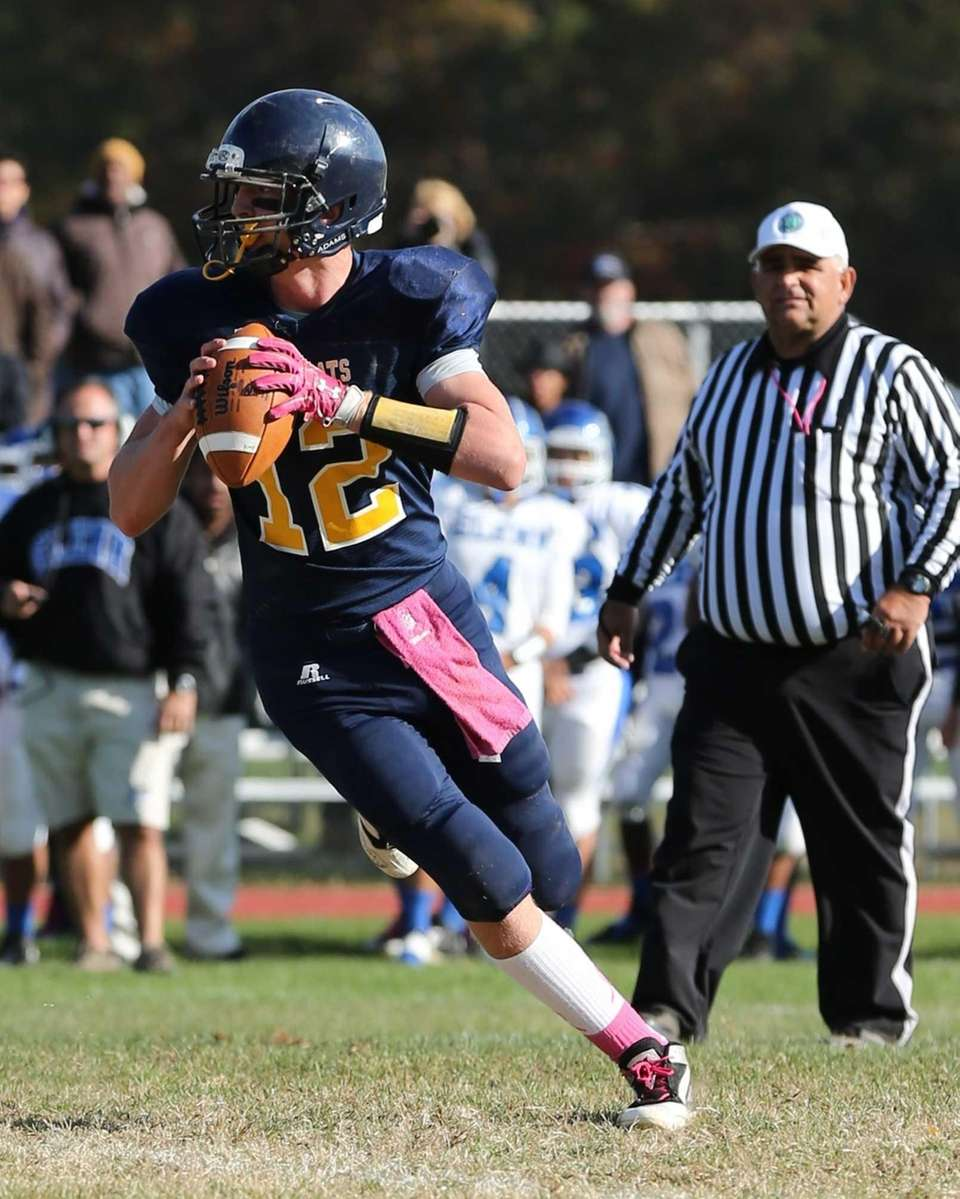 Shoreham-Wading River quarterback Daniel Hughes looks to pass