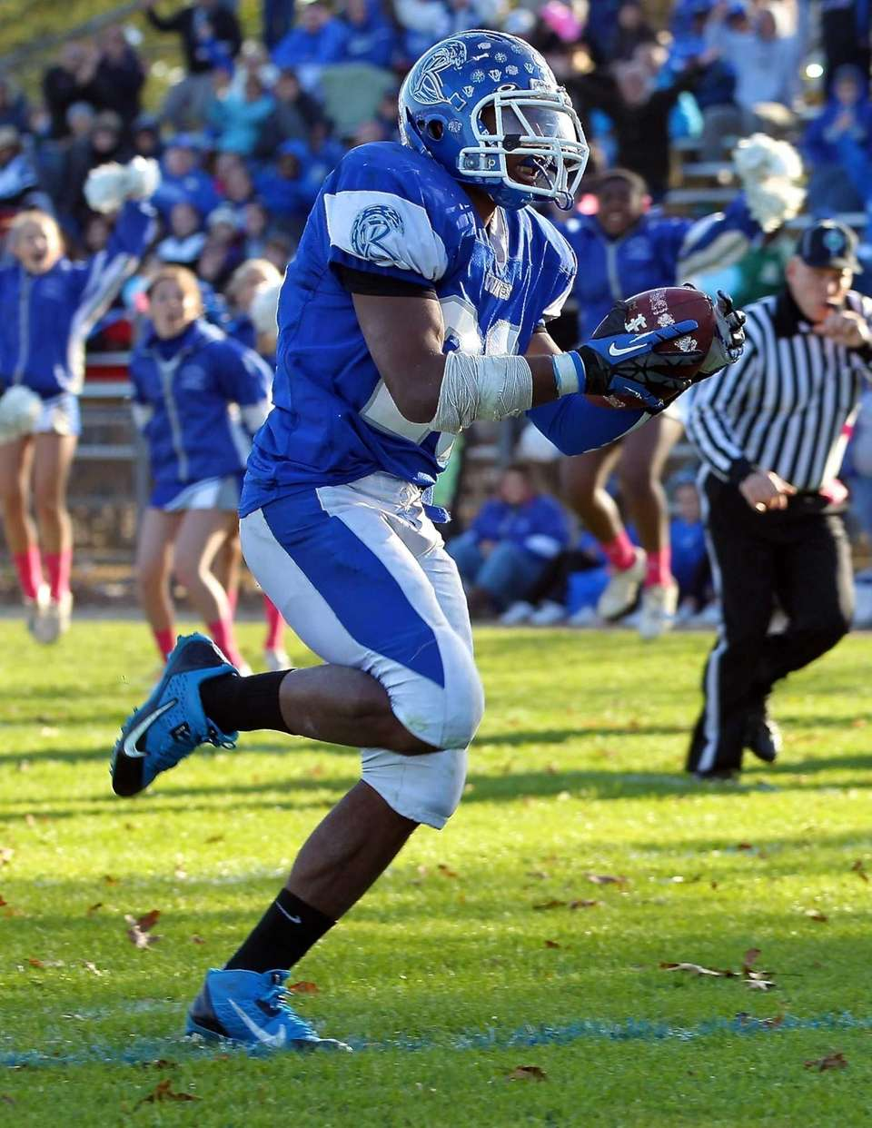 Riverhead running back Jeremiah Cheatom scores a fourth-quarter