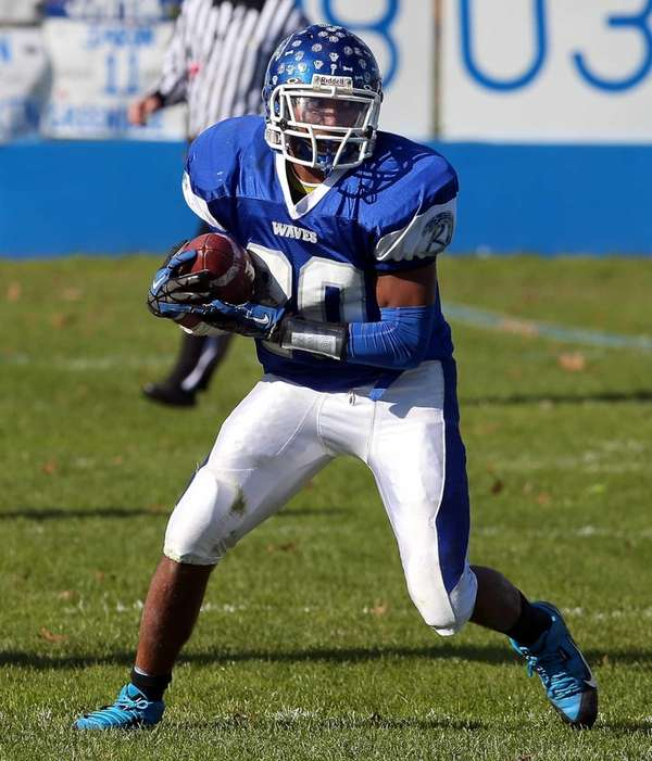 Riverhead running back Jeremiah Cheatom looks to run