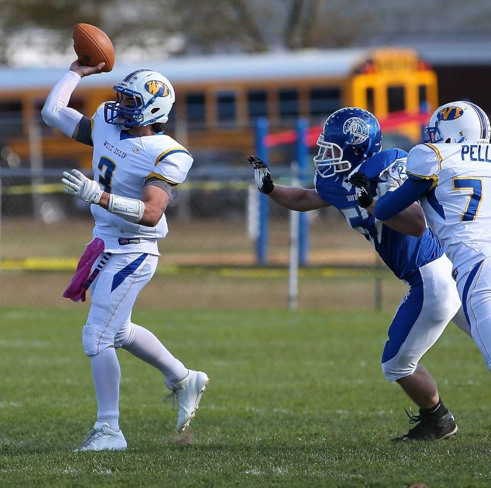West Islip quarterback Sam Ilario (no. 3) attempts