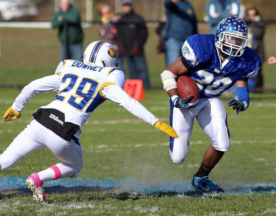 Riverhead running back Jeremiah Cheatom (right) gets past