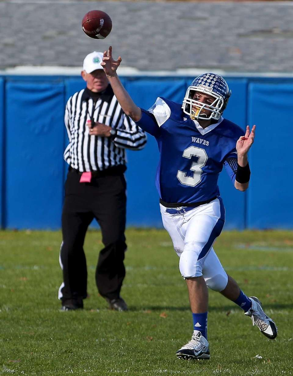 Riverhead quarterback Cody Smith attempts a pass during