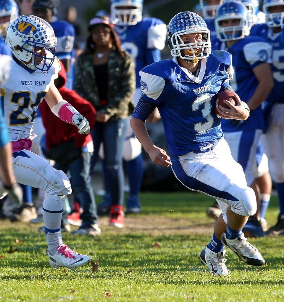 Riverhead quarterback Cody Smith (no. 3) rushes down
