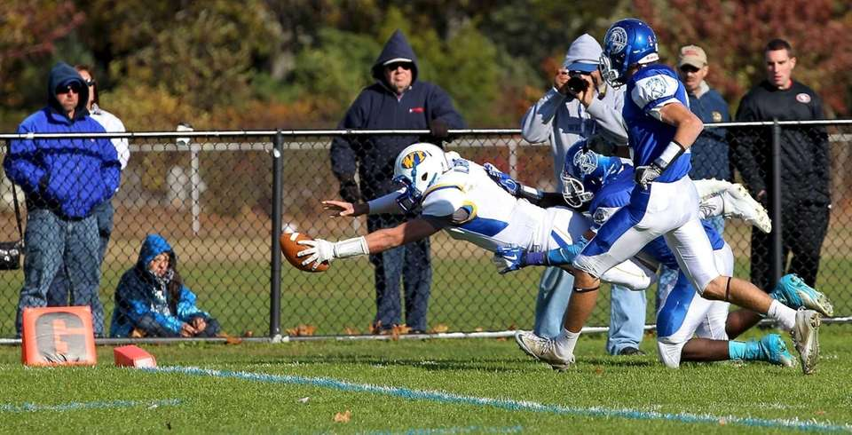 West Islip quarterback Sam Ilario dives into the