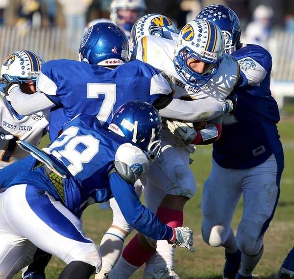 West Islip running back Max McNicholas is stopped