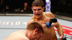 Al Iaquinta, right, punches Piotr Hallman in their