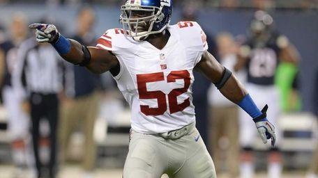 Giants linebacker Jon Beason calls a play against