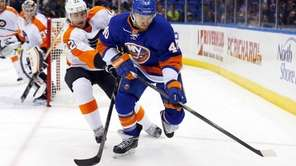 Michael Grabner of the Islanders tries to control