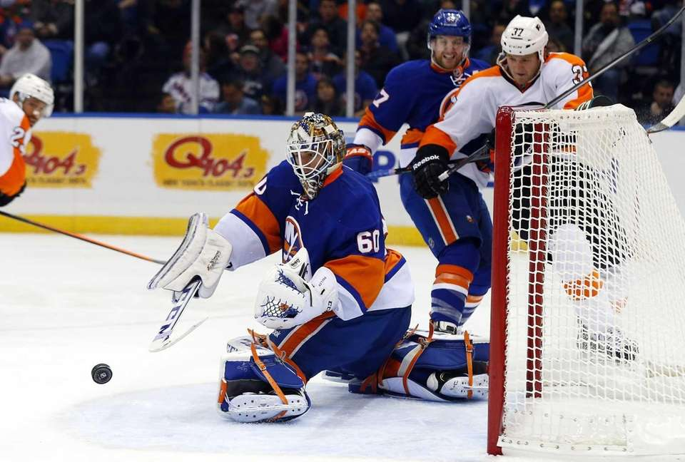Kevin Poulin of the Islanders makes a second-period
