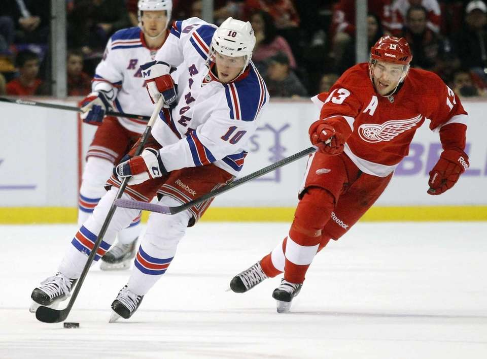 Rangers center J.T. Miller (no. 10) is pursued