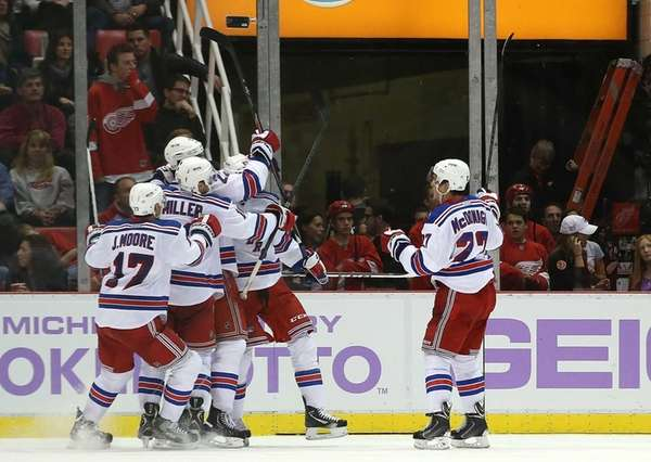 Benoit Pouliot of the Rangers celebrates with his
