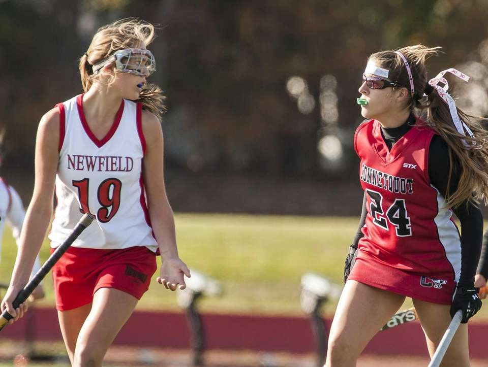 Newfield's Michelle Loken (left) looks at Conetquot's Erin