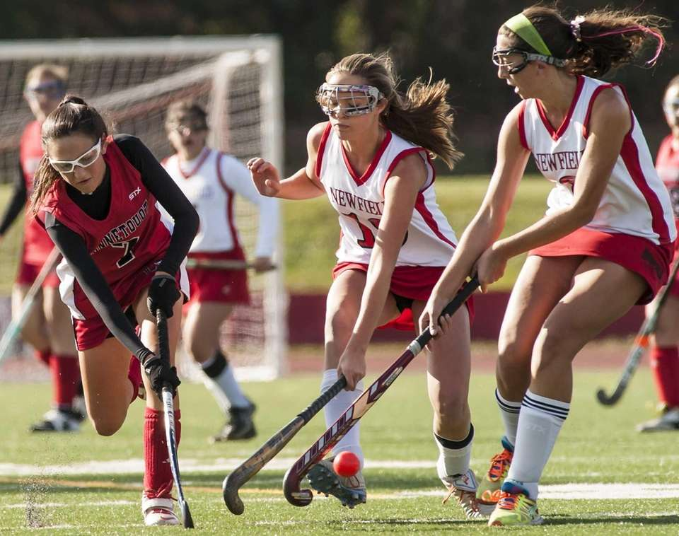 Connetquot's Gabrielle Martinez (no. 7, left), manages to