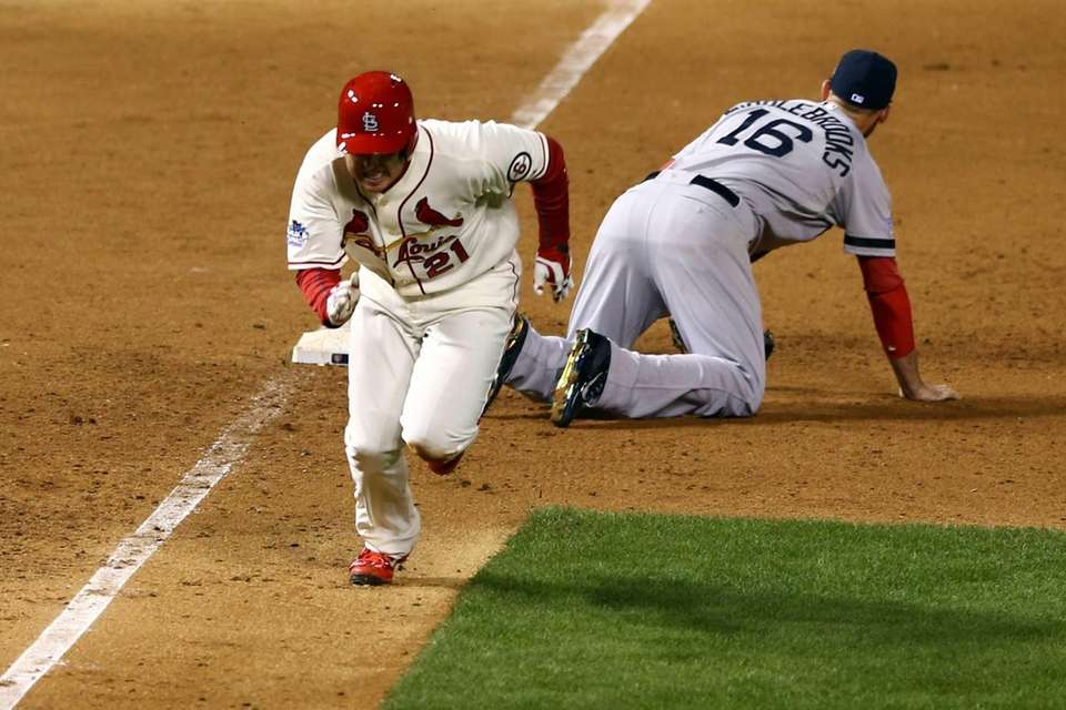 St. Louis Cardinals baserunner Allen Craig runs after