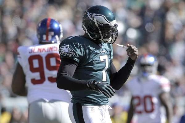 Philadelphia Eagles quarterback Michael Vick reacts after being