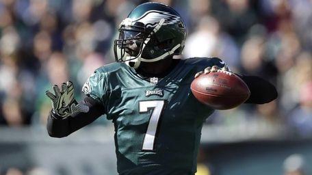 Philadelphia Eagles quarterback Michael Vick throws a pass