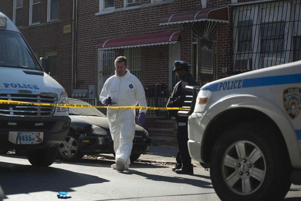 NYPD crime scene unit members gather evidence in