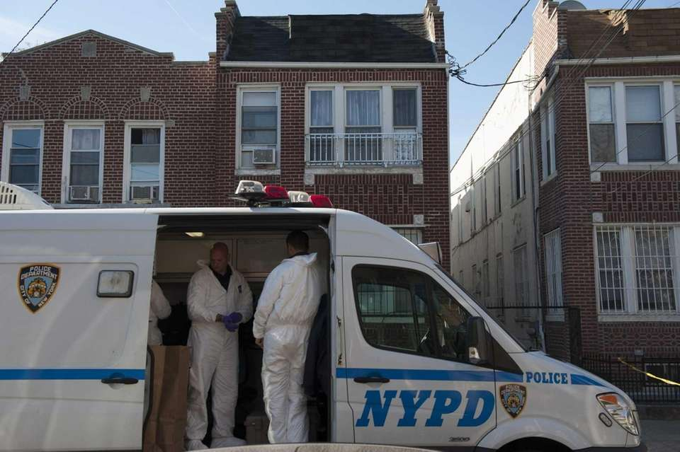 Members of the NYPD's Crime Scene Unit gather