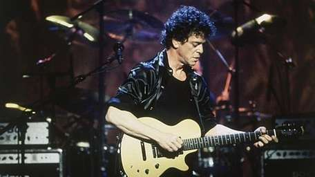 Lou Reed performs in concert in 1997.