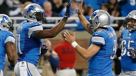 Detroit Lions wide receiver Calvin Johnson celebrates a